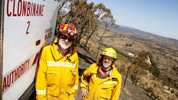 Clonbinane CFA captain Ross Hibbert (left) and brigade member Allen Snaith survey the destruction left by Black ...