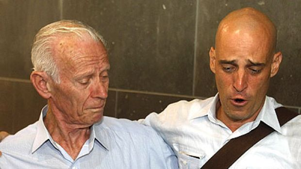 Harry Nicolaides (right) cries as he is embraced by his father Socrates at Melbourne Airport.