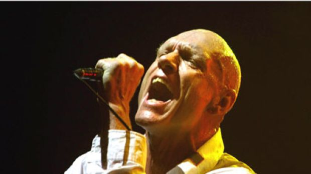 Peter Garrett in action with Midnight Oil at Sydney's Wave Aid benefit in 2006.