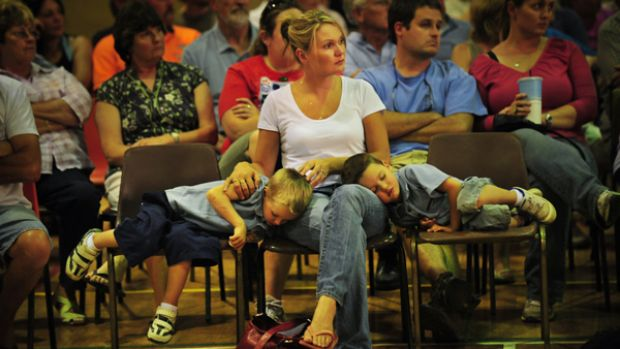 """Louise Scott and her sons Beau (left) and Coby at the Eildon Community Centre. """"It feels like someone's out to get me."""""""
