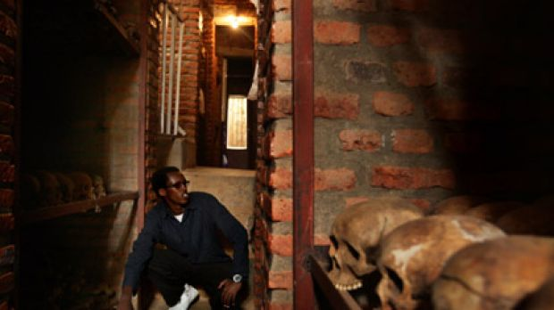 What lies beneath ... Igiraneza Bonus, 20, sits in the crypt under the Nyamata church, where his family was slaughtered ...