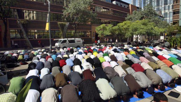 Muslim RMIT students pray in Bowen Street yesterday.