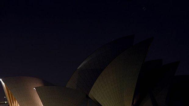 Bright idea . . . the Opera House turns off its exterior lights.