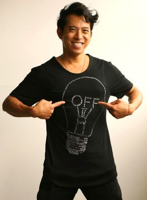 Light-bulb moment  ...  Bowie Wong with his  Earth Hour T-shirt  for auction.