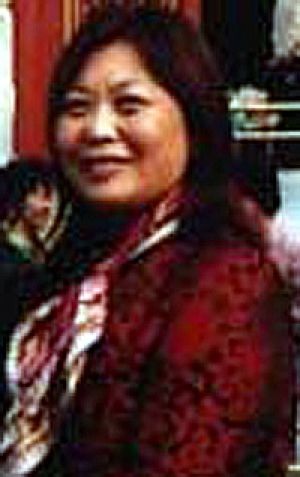 Helen Liu . . . paid for minister's trips to China.