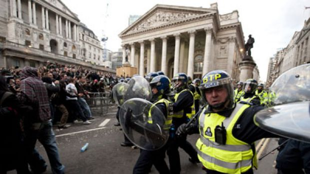 Police clash with protesters during a clash outside the Bank of England in London yesterday.