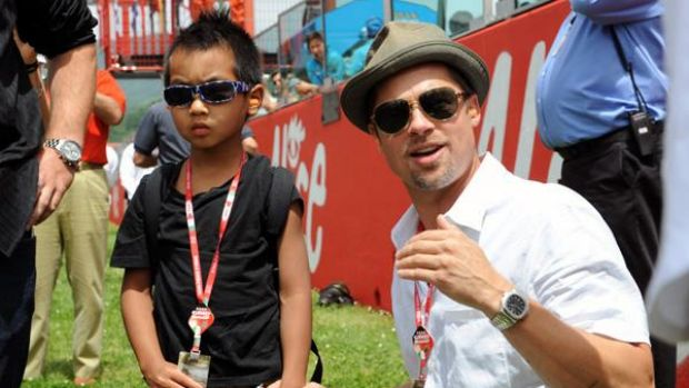 Special time ... Brad Pitt and Maddox Jolie-Pitt enjoy a family outing at the Italian Grand Prix in Mugello.