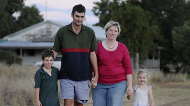 Happily ``unmarried''...the State Government says it has no record that Jodie and Marcus Hucker, pictured with their ...