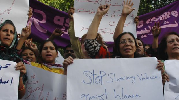 Pakistani women shout their protests at the public whipping of a girl by members of the Taliban, captured on video