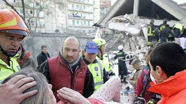 """A """"terrifying, bloody dawn''  . . . rescuers treat a woman injured in the earthquake that devastated the central Italian ..."""