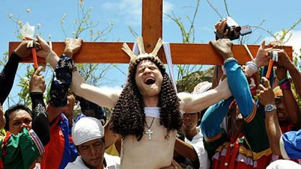 Australian 'John Michael' has his hands nailed to the cross in an imitation of Christ's death as part of Good Friday ...