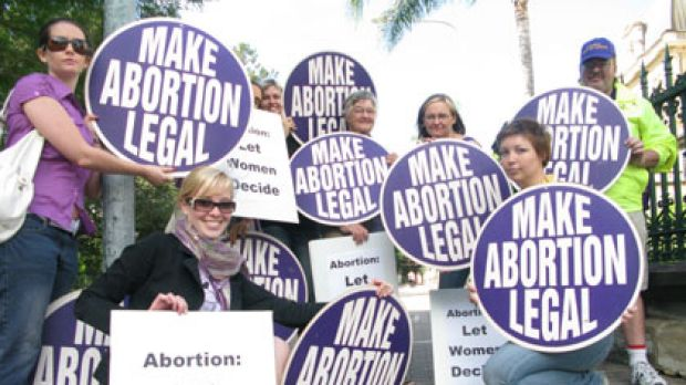 Pro-choice lobbyists rally outside Brisbane's Parliament House.
