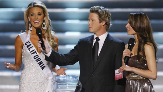 Against gay marriage ... hosts Billy Bush and Nadine Velazquez listen to Carrie Prejean's answer.