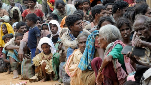 Human cost ... people take shelter in a northern village after fleeing an area still controlled by the Tamil Tigers.