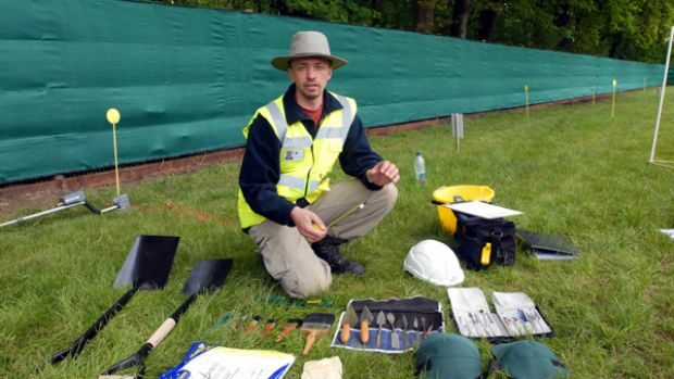 Tools are laid out to start the exhumation.