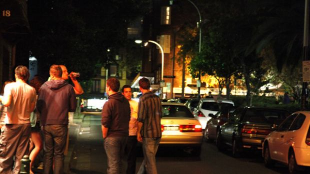 Footpath bar ... late-night revellers drinking on the street.