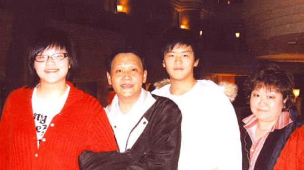 Hit-and-run victim ... Samuel Mei Hsiung (second from right) with his family.