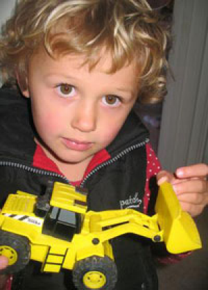 Pipi Quinlan, 3, with a toy digger, a fraction of the size and cost of the $20,000 Kobelco digger she won in a Trade Me ...