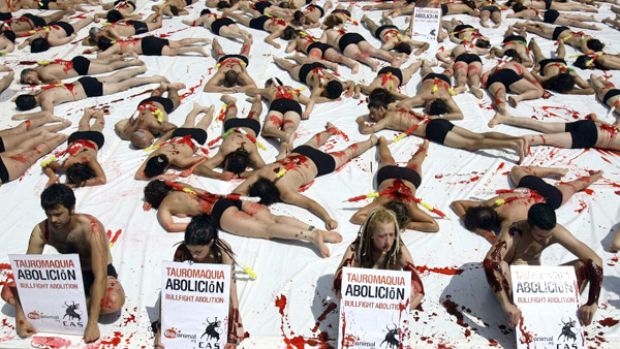 Animal rights activists covered in fake blood from the group Igualdad Animal (Animal Equality) protest during a ...