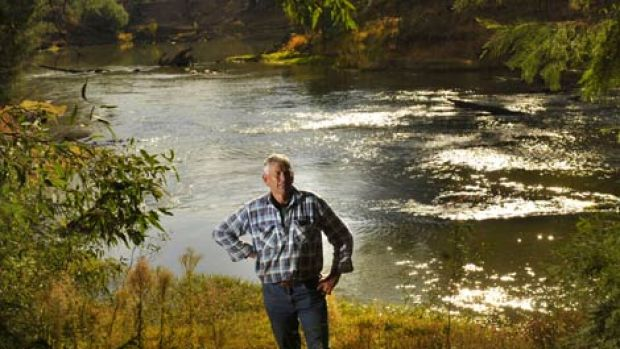 Farmer Russell Pell on a bank of the Goulburn River within his farm, which he has decided to keep stock off for ...