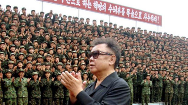 Flashback ... North Korean leader Kim Jong Il acknowledging applause from soldiers as he inspects the Korean People's ...