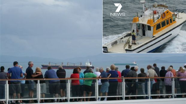 Passengers onboard the cruise ship Pacific Dawn wait to be released from quarantine, and (inset) the boat which ...