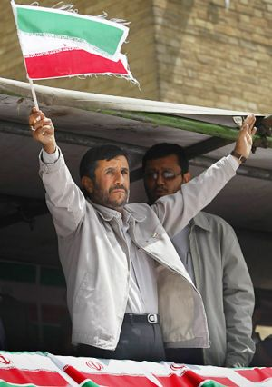 Mahmoud Ahmadinejad gestures to supporters at his last election campaign rally.
