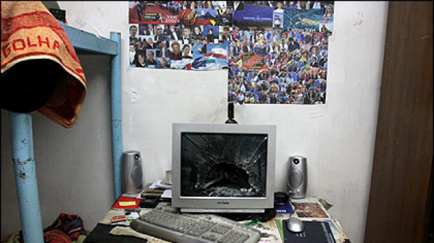(Top) A broken computer monitor in a room in a Tehran University dormitory after it was attacked by militia forces ...