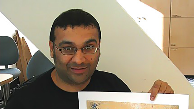 Canadian illustrator Gary Taxali with one of his pro-bono works made for Greenpeace.