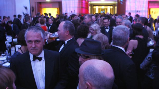 Liberal leader Malcolm Turnbull, pictured at Wednesday's Mid-Winter Ball, will reach out to women in a different manner ...