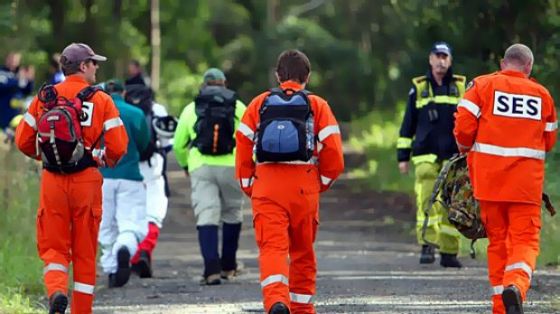 Members of the SES search for Bruce Ludbrook.