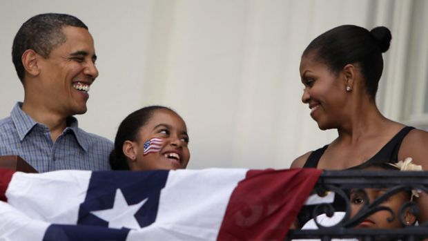 Barack Obama, Michelle and daughters Malia (centre) and Sasha during Fourth of July celebrations at the White House.