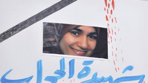 Egyptians flash a poster showing 32-year-old pregnant Egyptian woman Marwa el-Sherbini, top who was stabbed by a German ...