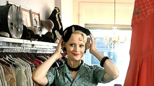 Sarah Doyle tries on an outfit in Coco Repose.