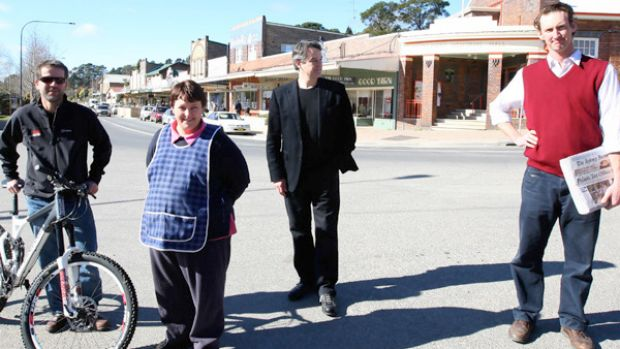 Bundanoon   moves to ban the sale of bottled water  ... (from left) bike and cafe shop owner Huw Kingston, deli owner ...