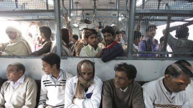 Overcrowded but do the job...about 12 million passengers must opt for unreserved seats on the hard wooden benches of ...