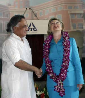 US Secretary of State Hillary Clinton shakes hands with Indian Minister of State for Environment and Forests Jairam ...