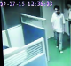 A video screen grab obtained by the Southern Metropolis Daily purporting to show Foxconn employee  Sun Danyong being let ...
