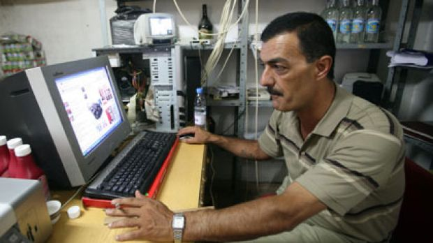 Christian Palestinian Ayman Abu Aitta watches extracts from the movie <i>Bruno</i> , over which he intends to take the ...