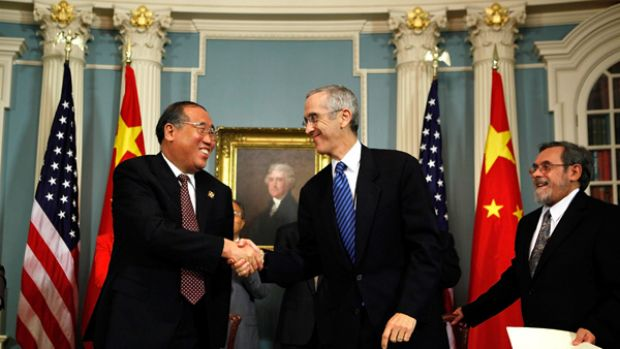 Vice-chairman of Chinese National Development Reform Commission Xie Zhenhua shakes hands with US Special Envoy for ...