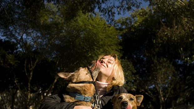 Cautious ... Madeleine Anderson, with Kuggee and Anu, is reluctant to stop vaccinating her dogs every year despite ...