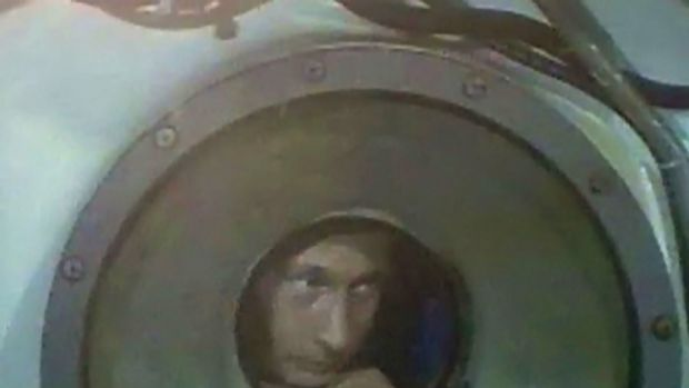Taking a dive ... Vladimir Putin inside a Mir-1 mini-sub during a journey to the bottom of Lake Baikal.