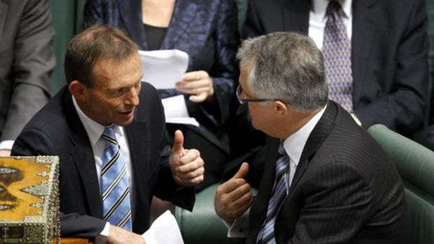Opposition Leader Malcolm Turnbull speaks to fronchbencher Tony Abbott in Parliament today.
