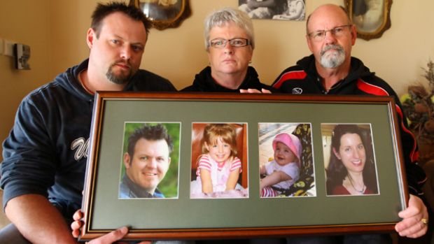 Leon and Joan Davey and son Shane with pictures of Rob Davey and his wife Natasha and children.