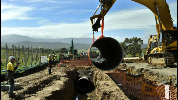The last length of pipe is laid.