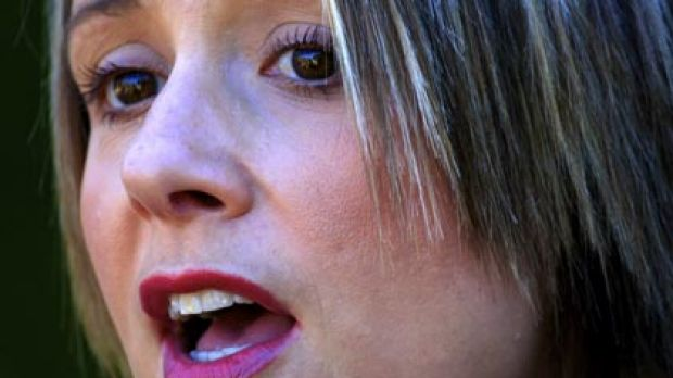 Often observed applying lip gloss during question time...Kristina Keneally fronts the media yesterday.