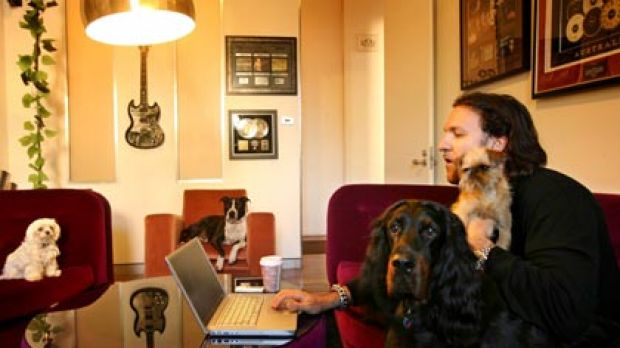 """""""A good vibe for everyone""""...Adam Zammitt at his workplace in Glebe. With him are, from left to right, Millie, Vegas, ..."""