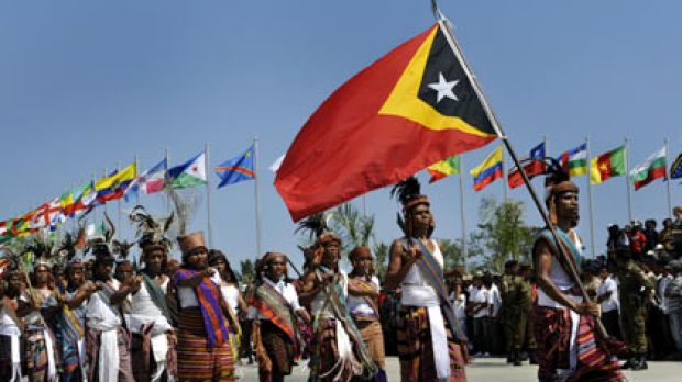 Celebrations . . . Traditional East Timorese tribal warriors take part in the official procession to mark the country's ...