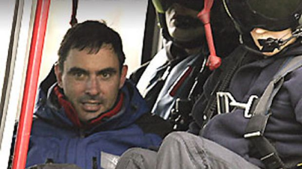 Found alive ... Victorian minister Tim Holding in a rescue helicopter.