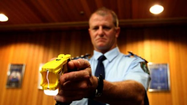 Non-lethal weapon...NSW police officer Bob O'Riordan holds Taser stungun with the double handed Glock grip. More police ...